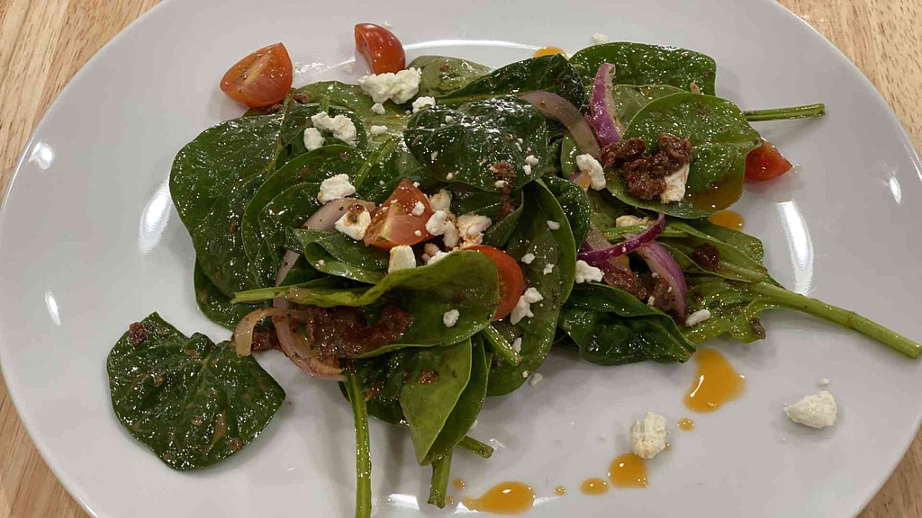 Spinach Salad with feta cheese on a plate