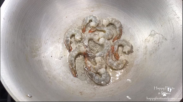 shrimp being cooked in wok