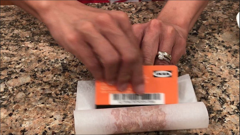 using a credit card with paper to form a sausage