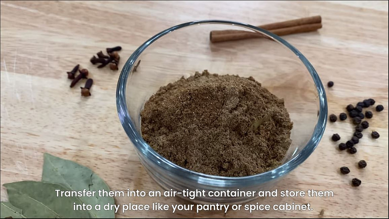 garam masala in a cup with ingredients a long side.
