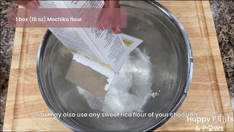Mochiko flour being poured into a mixing bowl for butter mochi recipe