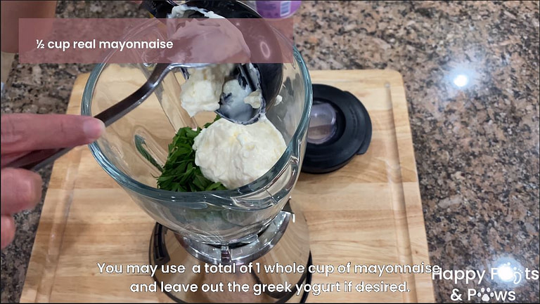 mayonnaise being added to a blender for creany garlic dressing