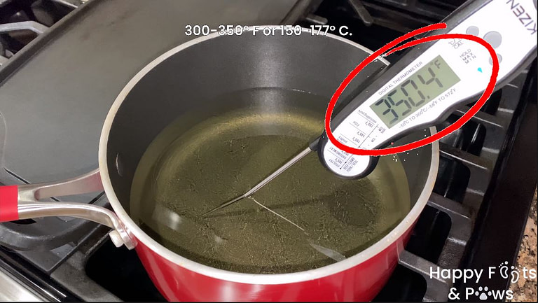 heated oil in a pot to cook lumpia shanghai