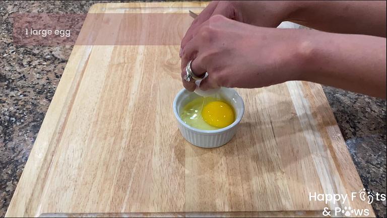 cracking egg in dish for egg wash