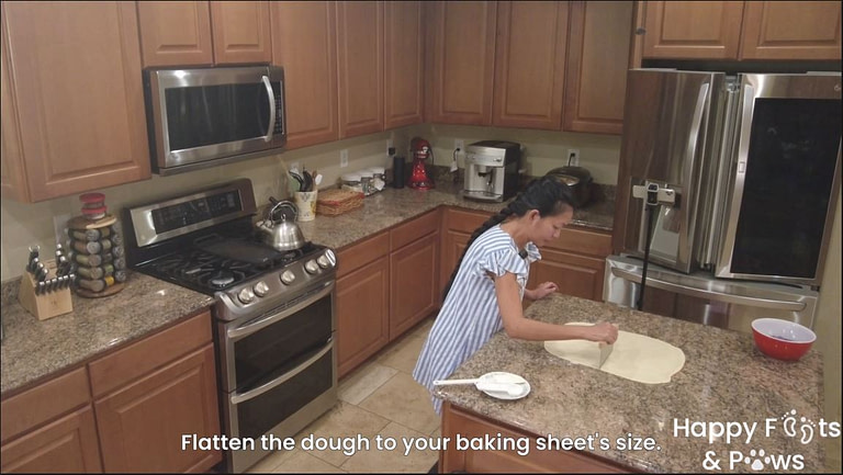 woman cutting dough prior to baking ube bars bread