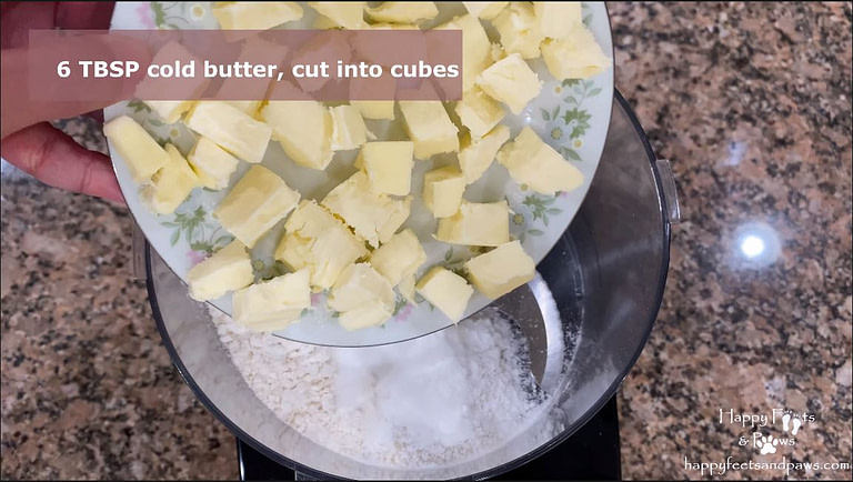butter being added to flour for biscuits and gravy recipe