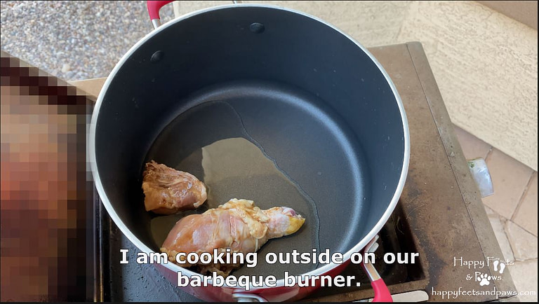 cooking meat in a pot with oil on a bbq for Filipino Adobo recipe.