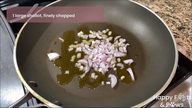 shallots sauteeing on a pan with oil