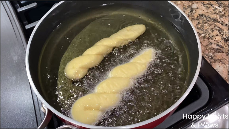 frying shakopy in a pot with oil